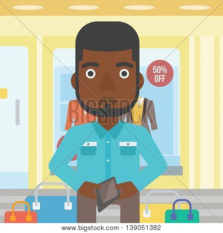 An african-american young man showing his wallet purse on the background of showcase of a store. Vector flat design illustration. Square layout.