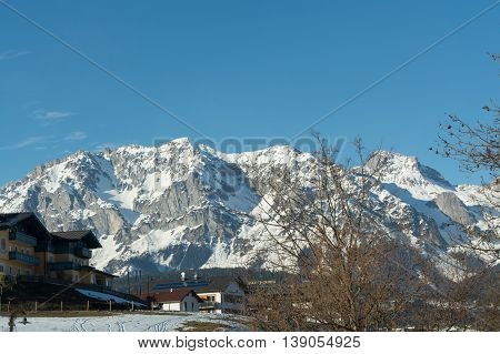 Winter holiday area Dachstein Region - snowy mountains and sunny tourist center
