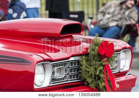 Taunton Massachusetts USA - December 5 2010: Classic Plymouth sporting wreath in Taunton Christmas Parade