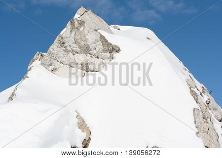 Closeup of a snowy mountain in the Northern Limestone Alps