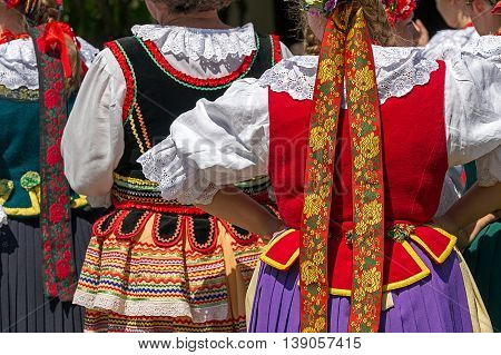 Detail of Polish folk costume for woman with multicolored embroidery.
