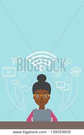 An african-american woman working on a laptop and social computer network icons above him. Vector flat design illustration. Vertical layout.
