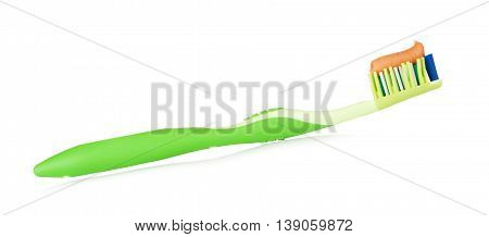 green toothbrush with herbal toothpaste, isolated on white