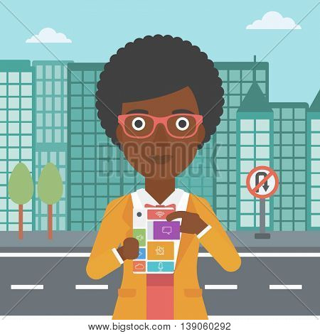 An african-american woman holding modular phone. An african-american woman with modular phone standing on a city background. Woman using modular phone. Vector flat design illustration. Square layout.