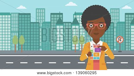 An african-american woman holding modular phone. Woman with modular phone standing on a city background. Woman using modular phone. Vector flat design illustration. Horizontal layout.