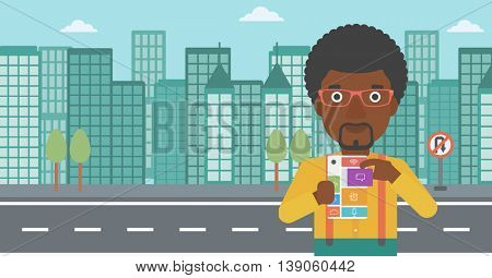 An african-american man holding modular phone. Young man with modular phone on a city background. Man using modular phone. Vector flat design illustration. Horizontal layout.