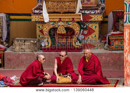 LAMAYURU INDIA - JUNE 13 2015: Unidentified three buddhist monk during mystical mask dancing Tsam mystery dance in time of Yuru Kabgyat Buddhist festival at Lamayuru Gompa Ladakh North India