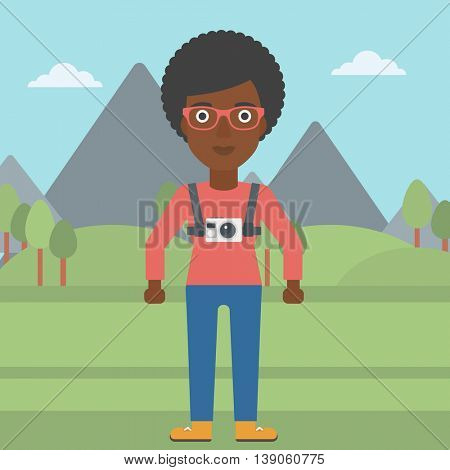 An african-american woman with a digital camera on her chest. Tourist with a digital camera standing on the background of mountains. Vector flat design illustration. Square layout.