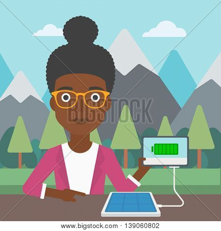 An african-american woman charging tablet computer with solar panel on a background of mountains. Charging digital tablet from portable solar panel. Vector flat design illustration. Square layout.