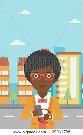 An african-american woman holding a smartphone looking at her smart watch. Synchronization between smartwatch and smartphone. Vector flat design illustration. Vertical layout.
