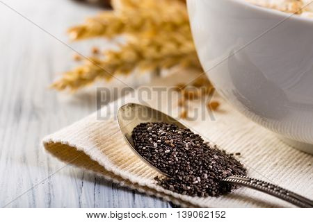 Wheat earl with chia seeds. Spoon with chia seedsl.