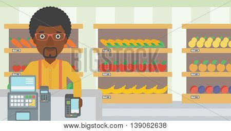 An african-american man paying wireless with his smartphone at the supermarket checkout . Male customer making payment for purchase with smartphone. Vector flat design illustration. Horizontal layout.