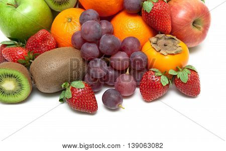 ripe strawberries and other fruits closeup on a white background. horizontal photo.