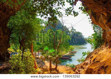 An Ancient Religious Cave. Inside View Of The Beautiful Landscape With The Boats. Hpa-an, Myanmar. B
