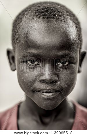 BOR, SOUTH SUDAN-NOVEMBER 4, 2013: Portrait of an unidentified South Sudanese boy with determined expression