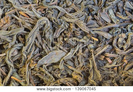 Abstract background - dried tea leaves close-up