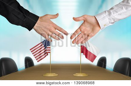 United States and Poland diplomats shaking hands to agree deal