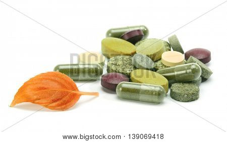 vitamins, pills, tablets and leaf