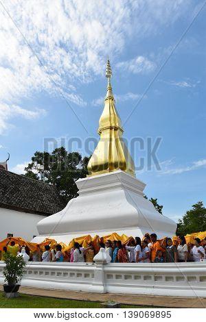 Khon Kaen Thailand - July 19 2016: Khon Kaen people attended the ceremony blanket Phra That Kham Kaen. In the season of Lent at Wat Phra That Kham Kaen Khon Kaen Province Thailand.