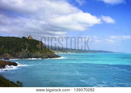 Cliff rock and building on the sea on sunset. Quercianella coast Tuscany riviera Italy Europe.