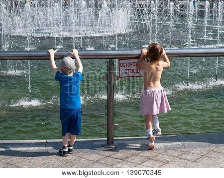 May 2016, Moscow, Russia. Children play near the musical fountain in Tsaritsino