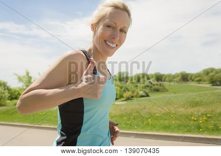 A mature woman running outdoors in the park