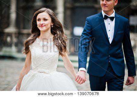Wedding Couple Walking On Streets Old City Lviv