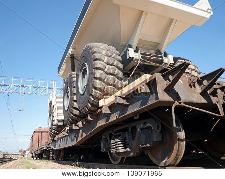 Transportation of huge mining trucks on a railway platform
