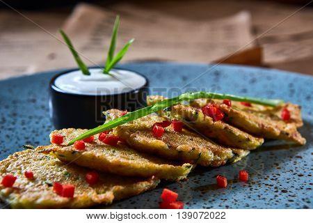 Vegan potato pancakes with sour soy cream
