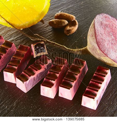 Set of chocolate candie with beetroot and orange, chocolate collection