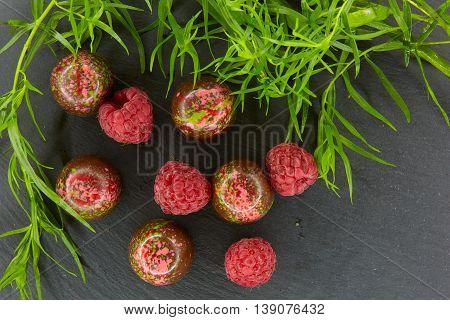 Set of chocolate candie with tarragon and raspberry, chocolate collection