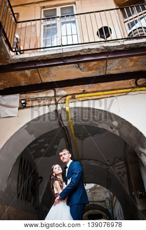 Wedding Couple Under Arch Of Street Old Town