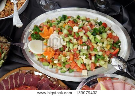 Classic Croatian plate with fine salad with cheese, pepper, cucumber and tomatoes