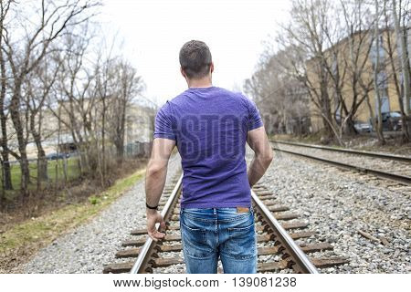 A nice young man portrait on the railroad