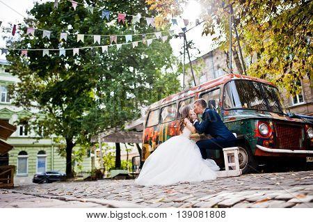 Wedding Couple Near Old Retro Bus Car