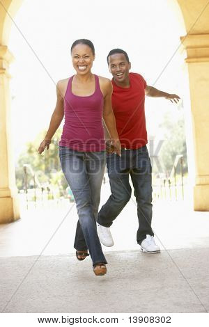 Young Couple Visiting Building In City