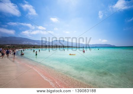 CRETE ISLAND, GREECE - JUNE 27: People relaxing at Elafonisi beach in Crete island, Greece on 27 June 2016. Elafonissi is one of the best Greek beaches. There are pink  sand.