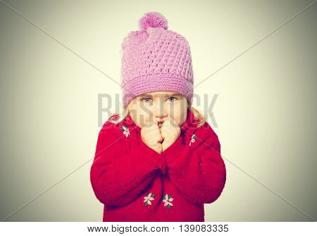 Little Funny Girl In Cap And Red Sweater.