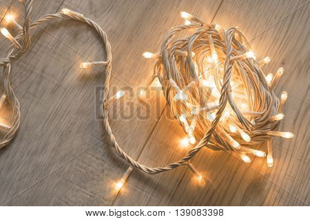 Yellow flash lights on wooden floor as a background