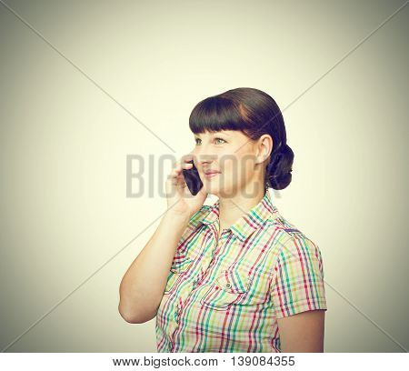 Brunette Girl Talking On Mobile Phone Isolated