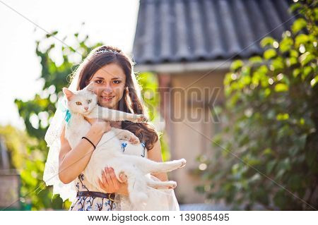 Girl Bride  Holds On Hands White Cat With Different Colored Eyes