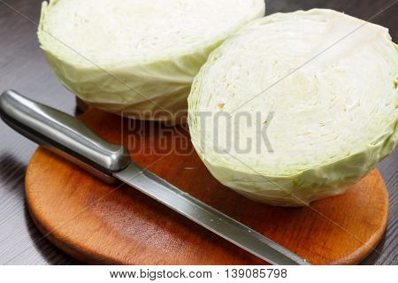 Cutting cabbage on a board chef cooking