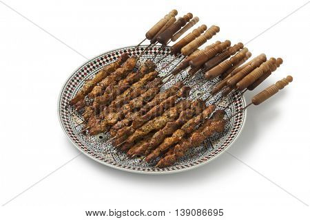 Dish with Moroccan lamb kebab on white background