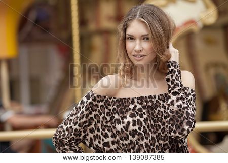Portrait Of Young Beautiful Woman. beautiful young brunette fashion model posing outdoor. Summer outdoor portrait. Focus on woman, blurred background