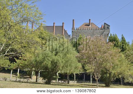GUIMARAES, PORTUGAL - AUGUST 9, 2016: Palace of the Dukes of Braganza seen from the close gardens in Guimaraes Portugal.