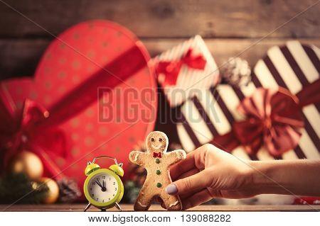 Female Hand Holding Gingerbread Man