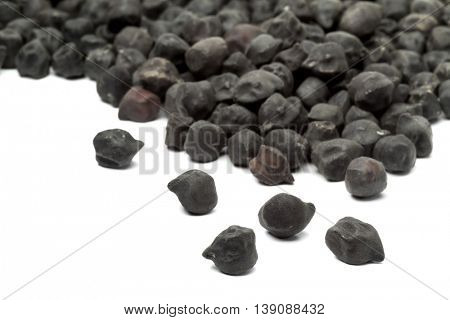 Heap of black Ceci neri chickpeas on white background