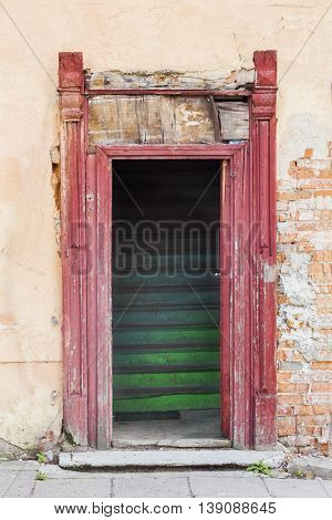Old house doorway with green wooden  stairs
