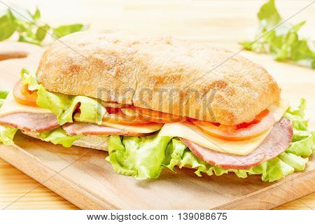 Big Ciabatta Sandwich with Bacon, Lettuce, Tomato, Cheese and Sauces