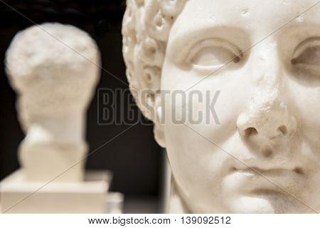 Roman bust of a woman. Face Closeup
